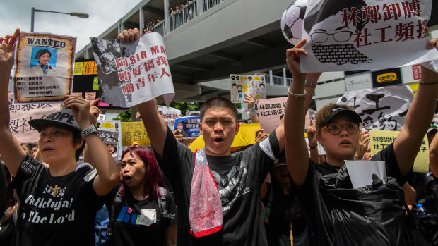 Social workers gather outside the legislative council building to participate in an anti-government march in Hong Kong on July 21st, 2019, in Hong Kong.