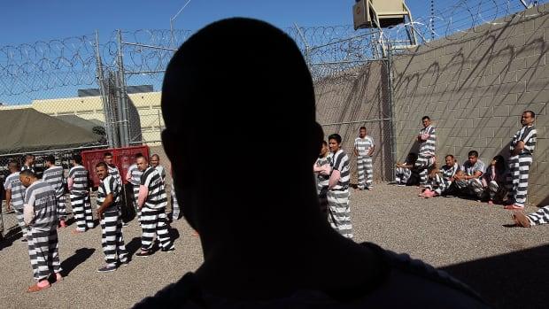 "Undocumented immigrants gather in the Maricopa County ""Tent City Jail,"" run by Sheriff Joe Arpaio, in Phoenix, Arizona, in 2010."