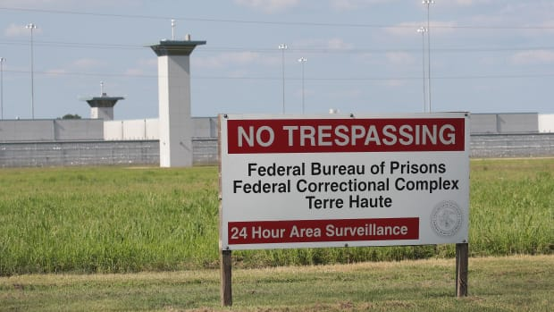A sign warns away trespassers at the Federal Correctional Complex Terre Haute on July 25th, 2019, in Terre Haute, Indiana, where prisoners on federal death row are held.