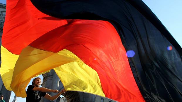 A man waves a German flag.