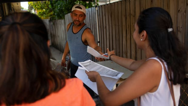 Immigration advocates with the Florida Immigrant Coalition go house to house handing out fliers on July 13th, 2019, in Little Havana in Miami, Florida.
