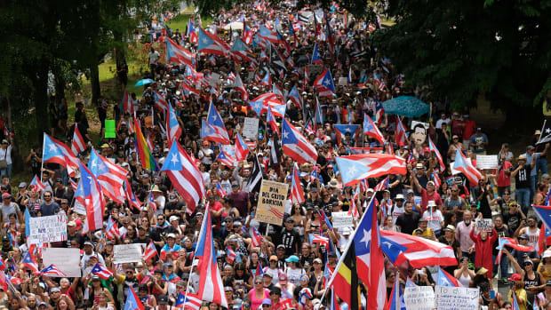People march in San Juan on July 25th, 2019, one day after the Puerto Rico Governor Ricardo Rossello announced his resignation.