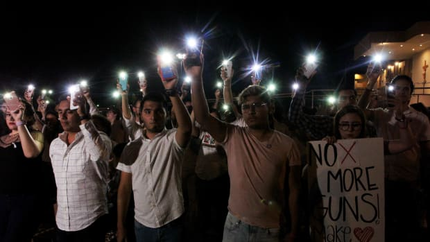 A vigil in Ciudad Juarez, Mexico, on August 3rd, 2019, after a mass shooting left over 20 people dead in El Paso, Texas.