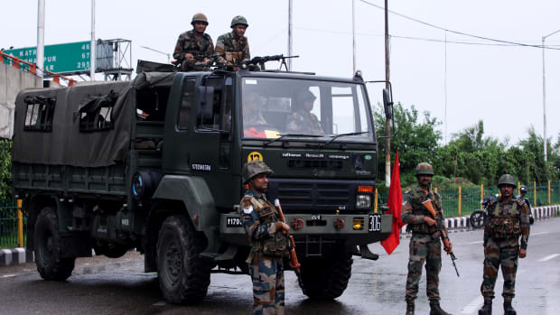 Security personnel stand guard on a street in the Indian state of Jammu and Kashmir on August 5th, 2019.