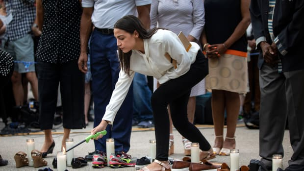 Representative Alexandria Ocasio-Cortez (D-New York) lights a candle during a vigil for the victims of the recent mass shootings in El Paso, Texas, and Dayton, Ohio, in Grand Army Plaza on August 5th, 2019, in Brooklyn. Lawmakers and local advocates called on Congress to enact gun control legislation and encouraged citizens to vote for politicians who would support those measures.