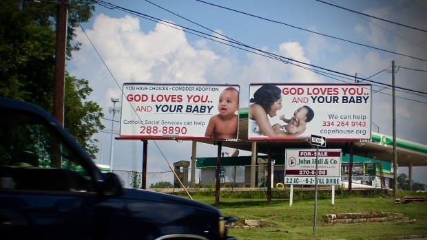 Signs for COPE Pregnancy Center in Montgomery, Alabama.