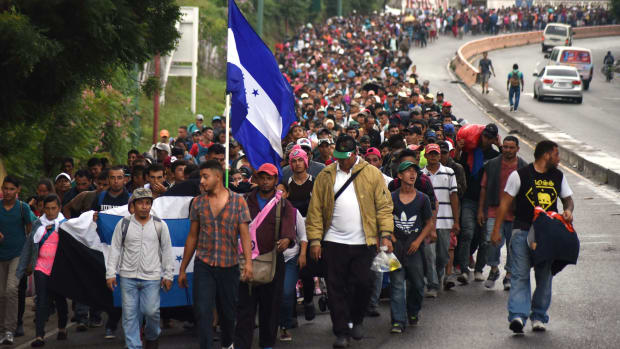 Honduran migrants take part in a caravan toward the United States in Chiquimula, Guatemala, on October 17th, 2018.