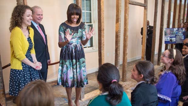 Michelle Obama says hello to sixth graders from Fairfax, Viginia's Willow Springs Elementary School during a surprise visit to the Decatur House in Washington, D.C., on May 22nd, 2013. The Decatur House is a National Trust for Historic Preservation Site that received a $ 1 million grant to fund educational programming.