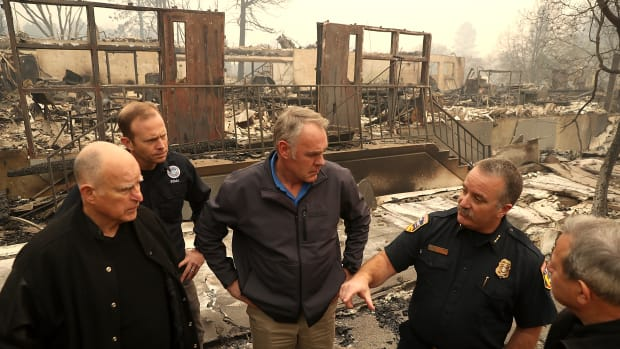 California Governor Jerry Brown, FEMA Administrator Brock Long and Secretary of the Interior Ryan Zinke tour a school burned by the Camp fire on November 14th, 2018, in Paradise, California.