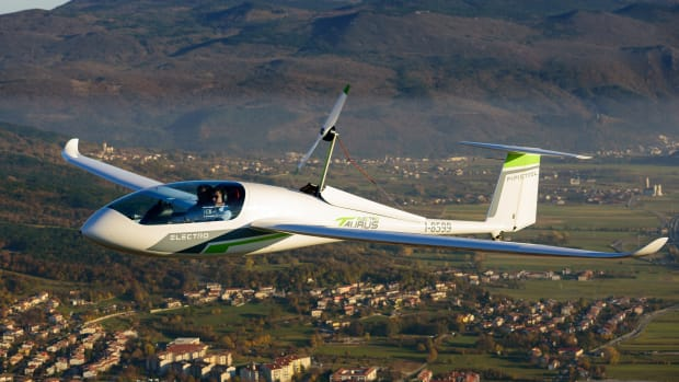 A Pipistrel Taurus Electro electric two-seat airplane flies above Ajdovscina, Slovenia, on November 10th, 2015.
