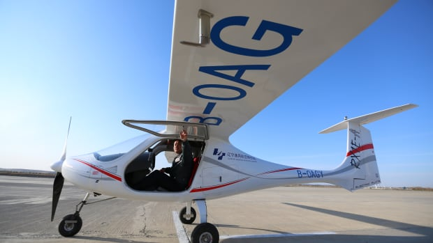 A pilot checks the RX1E-A, a two-seater aircraft designed by Shenyang Aerospace University, at Caihu Airport in Shenyang, Liaoning Province, China, on November 1st, 2017.