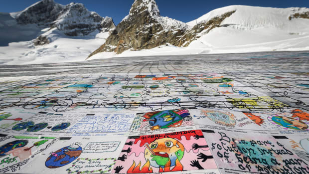 An aerial view shows a massive collage of 125,000 drawings and messages from children around the world, displayed on the Aletsch Glacier near the Jungfraujoch in the Swiss Alps, on November 16th, 2018. The mosaic of postcards, measuring 26,910 square feet, was laid out in the snow to boost a global youth climate movement ahead of COP24 in Poland.