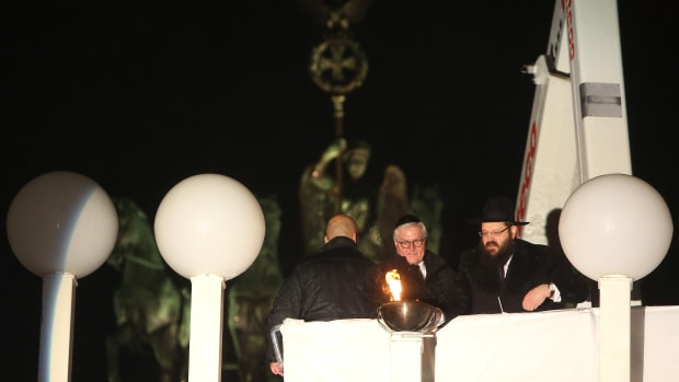 Rabbi Yehuda Teichtal (right) and German President Frank-Walter Steinmeier light Europe's largest menorah during a public lighting ceremony on the first night of Hanukkah, on December 2nd, 2018, in Berlin, Germany.