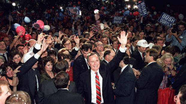 George H.W. Bush wades through the crowd on November 8th, 1988, following his acceptance speech at the Brown Convention Center, in Houston, Texas.