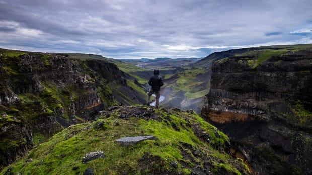 man takes a hike on a mountain