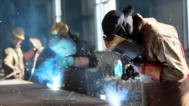 This photo taken on May 3rd, 2018, shows a worker cutting steel at a factory in Huaibei in China's eastern Anhui province.