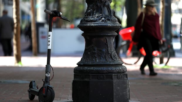A Bird scooter sits parked on a street corner on April 17th, 2018, in San Francisco, California.