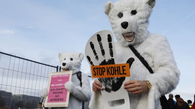 Activists hold placards and shout slogans against the energy policy of the German government during an anti-coal protest on December 1st, 2018, in Berlin, Germany. Protests took place in Berlin and Cologne ahead of the U.N. COP24 climate conference in Katowice, Poland.