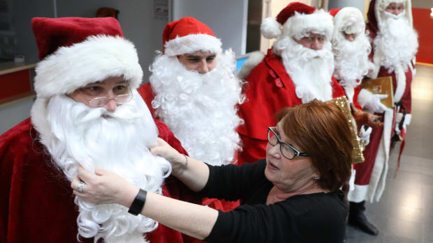 An employee at the job center in the city of Rostock, Germany, inspects candidates for a position at the center's Santa Claus agency on December 11th, 2018.