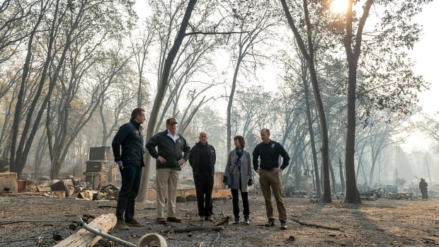 Governor-elect Gavin Newson, President Donald Trump, Governor Jerry Brown, Paradise Mayor Jody Jones and Federal Emergency Management Agency Director Brock Long tour an RV park during Trump's visit of the Camp Fire in Paradise, California, on November 17th, 2018.