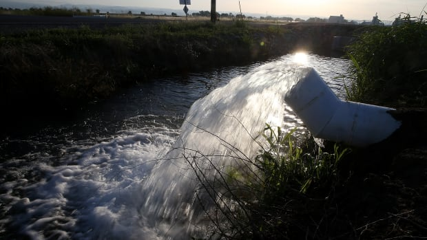 Water is pumped into an irrigation canal in Biggs, California.