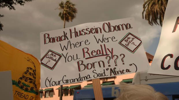 A demonstrator questions the citizenship of President Barack Obama at an American Family Association-sponsored protest against taxes and economic stimulus spending on April 15th, 2009, in Santa Monica, California.
