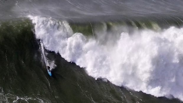 A surfer rides a wave at the famous Mavericks surf break on December 17th, 2018, in Half Moon Bay, California. A giant swell brought waves of up to 50 feet high to Northern California.
