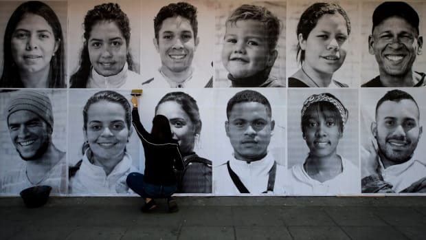 Portraits of Venezuelan migrants and refugees are displayed in Bogota, Colombia, as part of worldwide demonstrations in support of dignity for migrants for International Migrants Day on December 18th, 2018.