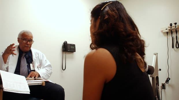 A woman speaks with her doctor on November 27th, 2002, in Newark, New Jersey.