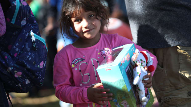 Envy Silva, whose family is originally from Guatemala, holds a holiday toy she received from immigration activists across the street from the Miramar Immigration and Customs Enforcement Facility, where asylum seekers, refugees, and immigrants come from across South Florida for their ICE check-ins, on December 19th, 2018. The activists wanted to show a message of love and unity amid what they say are attacks on immigrants in the United States.