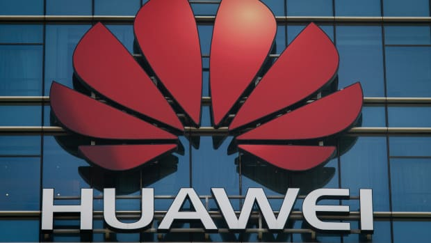 The Huawei logo stands on a Huawei office building in Dongguan in Chinas southern Guangdong province on December 18th, 2018.