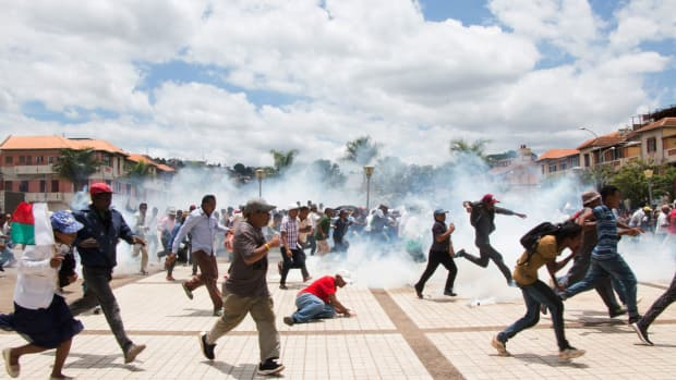 Security forces fire tear gas into a crowd of supporters of Madagascan presidential candidate Marc Ravalomanana, breaking up a demonstration against the country's election results on January 2nd, 2019, in Antananarivo. Ravalomanana, who lost to Andry Rajoelina in a run-off election on December 19th, claims he was denied victory because of fraud.