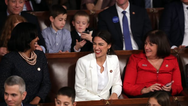 Representative Alexandria Ocasio-Cortez (D-New York) celebrates along with other members of Congress during the first session of the 116th Congress on January 3rd, 2019.