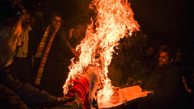 Indian Hindu activists burn an effigy of Chief Minister of Kerala Pinarayi Vijayan during a demonstration in the southern state of Kerala, in New Delhi, on January 3rd, 2019. Clashes broke out in southern India for a second day on January 3rd as Hindu hardliners went on a rampage, seeking to enforce a general shutdown in protest over two women entering Sabarimala Ayyapa, one of the country's holiest temples. The women were the first to enter the temple since a historic ban was lifted. A day after violence—both among rival groups and with police—left one man dead and 15 people injured; authorities said that 266 protesters had been arrested across the state of Kerala.