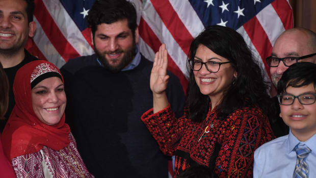 Representative Rashida Tlaib (D-Michigan), wearing a traditional Palestinian robe, takes the oath of office on Thomas Jefferson's Quran, with family members present in a swearing-in ceremony at the start of the 116th Congress at the U.S. Capitol in Washington, D.C., on January 3rd, 2019.