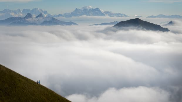 Tourists face a sea of mist engulfing the Alps from Moleson peak, Western Switzerland, on September 26th, 2015.