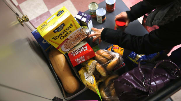 People receive free groceries at a food pantry run by the Food Bank For New York City on December 11th, 2013, in New York City.