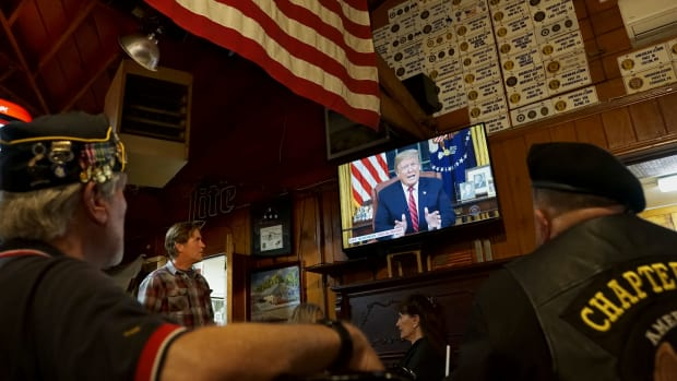 Members of American Legion Post 416 watch President Donald Trump speak on January 8th, 2019, in Encinitas, California.