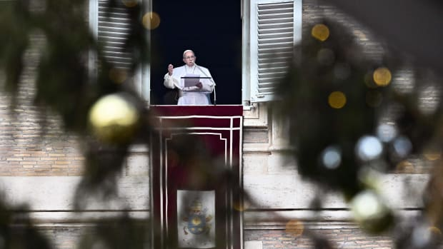 Pope Francis speaks from the window of the Apostolic Palace overlooking St. Peter's Square in the Vatican, during the weekly Angelus prayer, on January 13th, 2019.