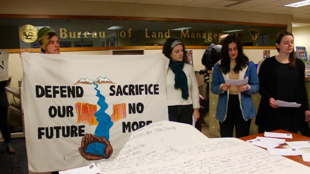 Young people protesting a Bureau of Land Management oil and gas lease sale in Salt Lake City read messages from those who oppose the sale.