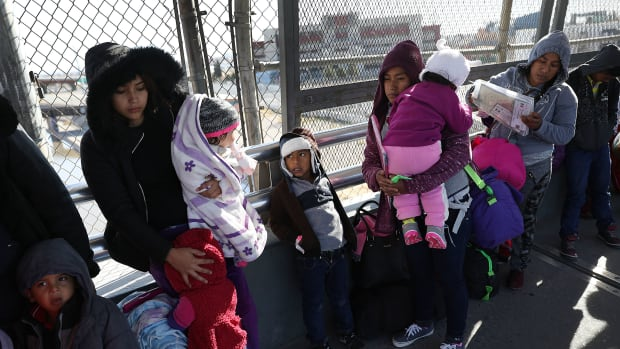 A group of people wait at the Paso Del Norte Port of Entry bridge to turn themselves in to the U.S. Customs and Border Protection personnel for asylum consideration on January 13th, 2019, in Ciudad Juarez, Mexico.