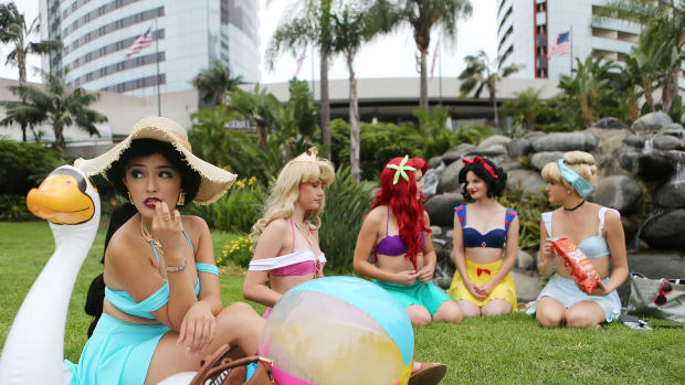 Cosplayers dressed as the Disney princesses lounging outside Comic-Con in San Diego, California, on July 20th, 2018.