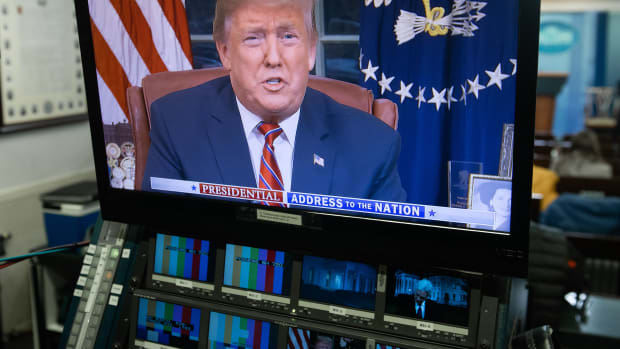 President Donald Trump's address about the government shutdown is streamed on a television screen in the Press Briefing Room of the White House in Washington, D.C., on January 8th, 2019.
