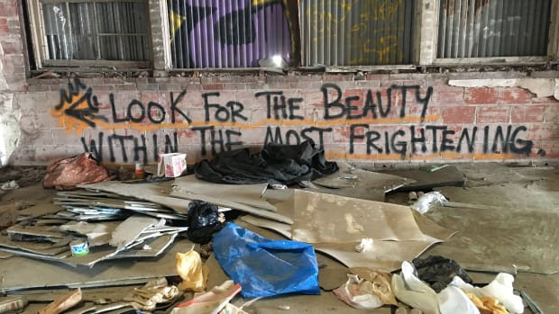 The inside of an abandoned warehouse on the northern end of downtown Houston hosts an encampment where approximately 20 homeless people stay each year.