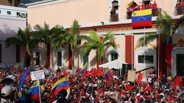 President of Venezuela Nicolás Maduro (center) gives a speech to his supporters from the Balcón del Pueblo of the Miraflores Government Palace on Wednesday, January 23rd, 2019, in Caracas, Venezuela. Earlier on Wednesday, Venezuelan opposition leader and head of the National Assembly Juan Guaido claimed that he is the rightful interim president, as was officially accepted by presidents of many countries such as the United States, Brazil, Chile, Canada, and Argentina. Protests continue in Caracas; meanwhile, Maduro and President Donald Trump no longer recognize any relations between their two countries.