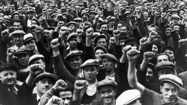 Striking building workers raise their fists in salute during a rally in Paris, on June 13th, 1936. The BLS just TKTK