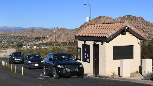 Tourists drive past the closed entrance ticket station of the Joshua Tree National Park after the federal government's partial shutdown caused park rangers to stay home and campgrounds to be shut, at the park in California, on January 3rd, 2019.