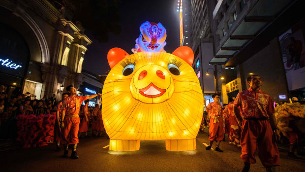Performers walk with a lit model of a pig during the annual Lunar New Year parade in the Kowloon district of Hong Kong on February 5th, 2019, to mark the Year of the Pig.