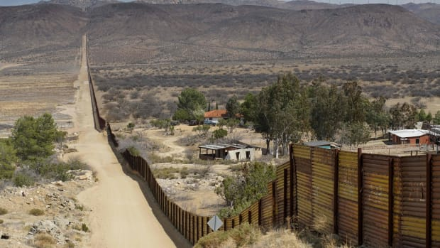 Houses are seen on the Mexican side of the U.S.–Mexico border fence on April 6th, 2018, in Jacumba, California.