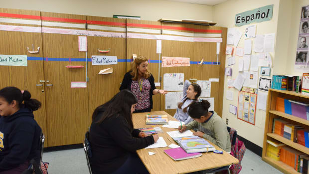Instructor Blanca Claudio (standing) teaches a history lesson in Spanish in a Dual Language Academy class at Franklin High School in Los Angeles, California.